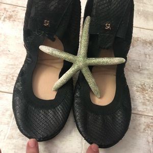 Black leather and suede ballet flats from Yosi.